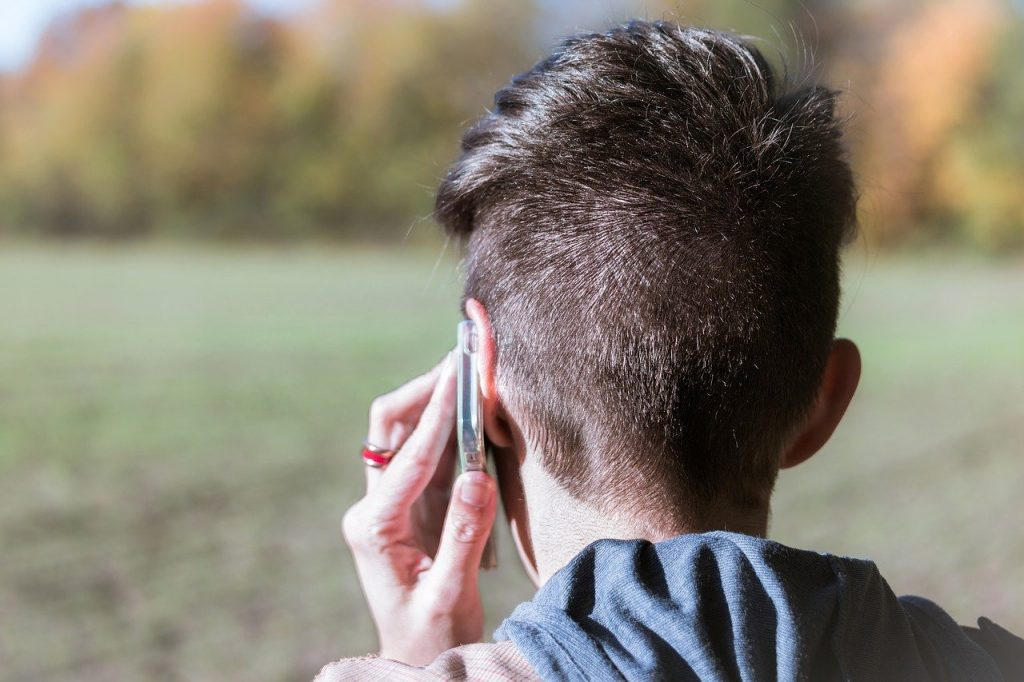 person holding a phone to their ear